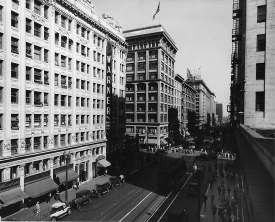 Looking east along Seventh Street, showing the Warner Brothers Downtown Theatre