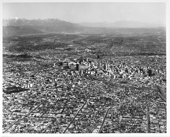 Aerial view of downtown Los Angeles County looking east from Olympic Boulevard and Vermont Avenue, convention center under construction