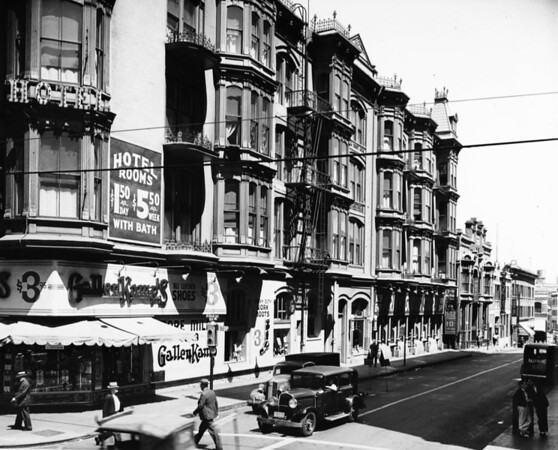 Fourth Street, view of rail tracks and overhead electric lines, and stores, including See's Candies and Hotel Barclay