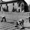 Two workmen laying out adobe bricks to be used in the restoration of the San Fernando Mission