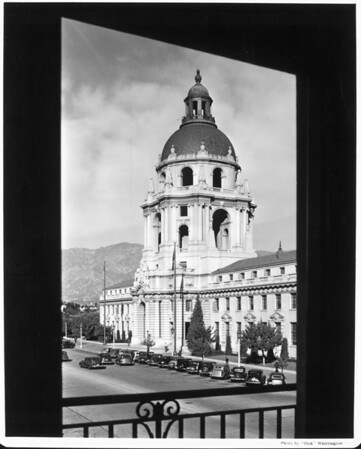 A low-angle view of the Pasadena City Hall cropped by trees