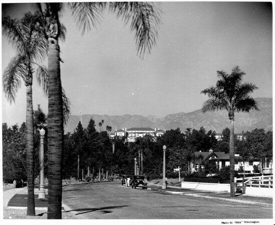 Looking down a residential street in Pasadena with the mountains in the background