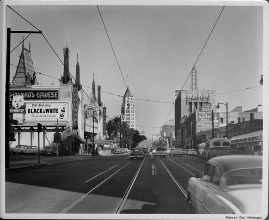 Looking down Hollywood Boulevard, Grauman's Chinese Theatre is seen on the left side of the road