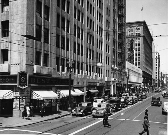 From the corner of Hill Street and Sixth Street the Union Pacific building and the car filled streets can be seen