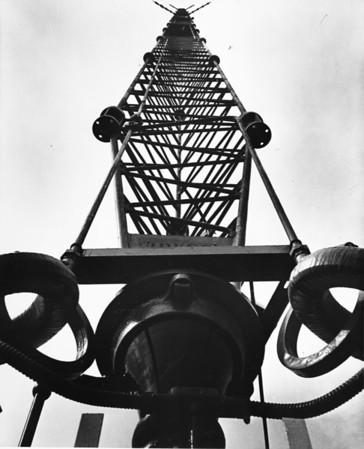 Photo taken from the bottom of a radio transmission tower, looking up