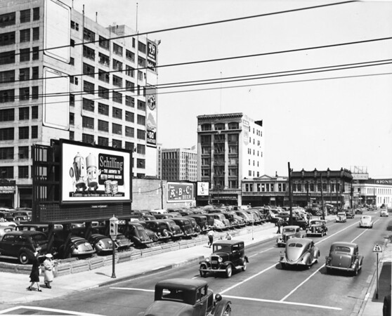 Photo of Signal Gasoline builiding, Petrol Building, Oasis Cafe, Sinclair Paint, and some advertisements