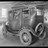 Ford sedan at Globe garage belonging to J. Granada, Southern California, 1930