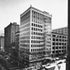 Corner view of the Cutts Building (formerly Sun Building) located at the corner of Hill Street and Seventh Street with the Roosevelt Loan Association located on the lower levels