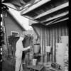 Man spraying tubs, California Tub Co., 1236 East 49th Street, Los Angeles, CA, 1930
