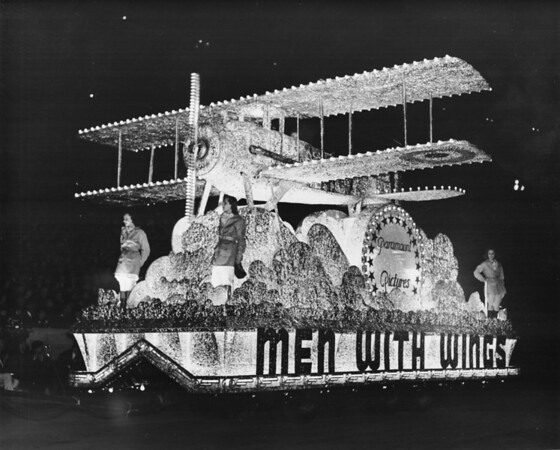 "Shriner's night time parade at the Coliseum, featuring Paramount Picture's' ""Men with Wings"" float"