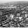 Aerial view facing north over Westwood at Wilshire Boulevard and Beverly Glen Boulevard. University of California at Los Angeles (UCLA) is in the background