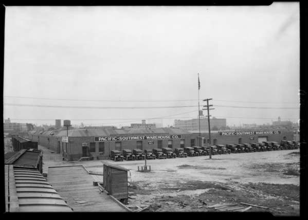 Fleet of trucks in front of building, Pacific-Southwest Warehouse Co., Los Angeles, CA, 1926