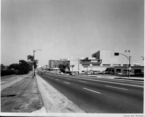 An extreme long shot of the Beverly Hilton Hotel along Wilshire Boulevard