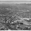 Aerial view of East Los Angeles, Atlantic Boulevard, Eastern Avenue, Santa Ana Freeway (I-5), Union Pacific Railroad yard