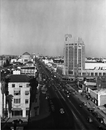 On Wilshire Boulevard facing west past Western Avenue, the Wiltern Theater, Wilshire Boulevard Temple