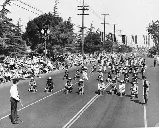 Women with buckets perform in the American Legion Parade