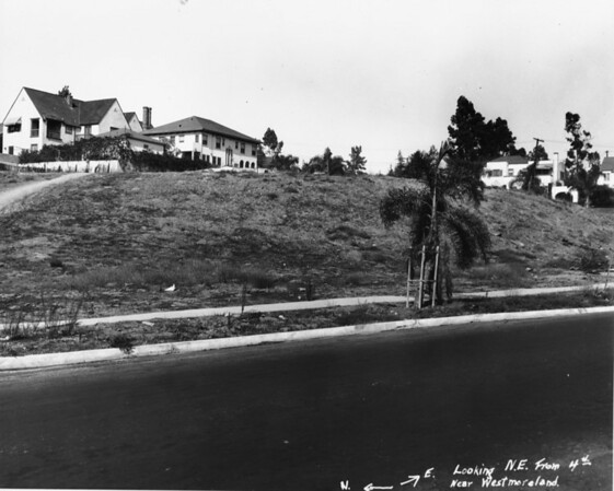 Looking northeast towards homes on a hill from West Fourth Street near Westmoreland Avenue