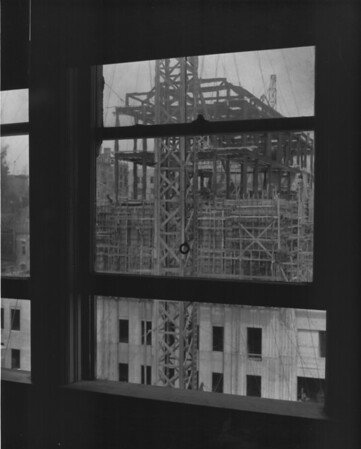 From the inside looking out at a building under construction