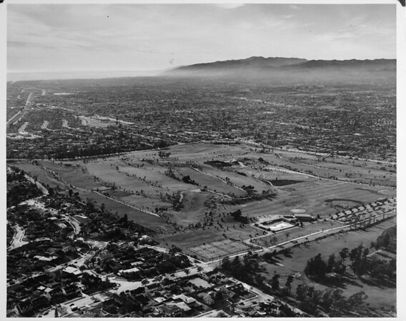 Aerial view facing west over the Rancho Golf Courses, the corner of the Hillcrest Country Club, West Los Angeles, Cheviot Hills, Rancho Park