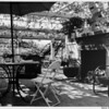 Residential Home in 1948, backyard, patio with fireplace, patio furniture
