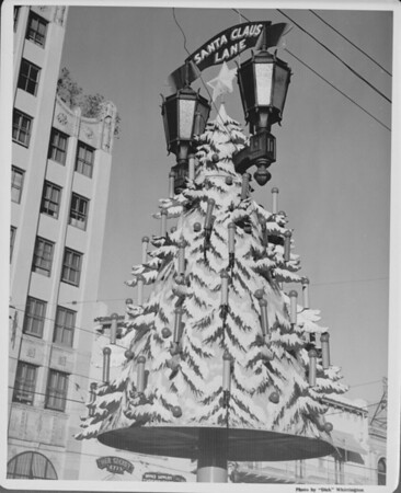 A lamp post becomes a Christmas tree as Hollywood Boulevard is turned into Santa Claus Lane for the Holidays