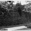 Exterior of residential home in 1948, landscaping, hedges