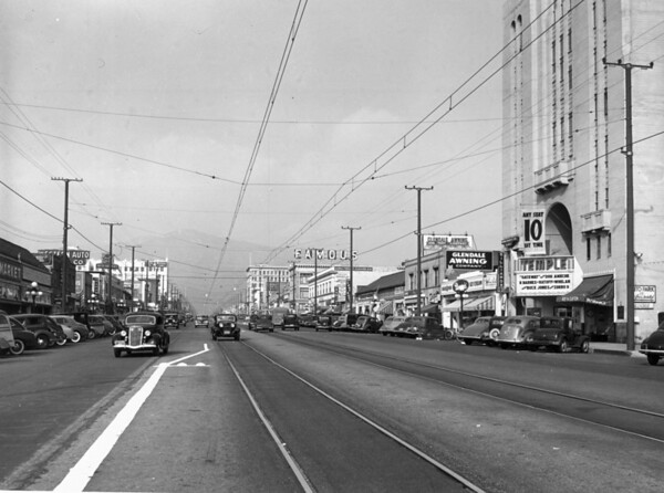 """View of Brand Boulevard looking north from Colorado Street in Glendale, CA, past the Temple theater, which is showing """"Gateway"""" with Don Ameche"""