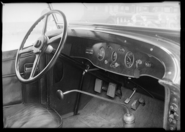 Hoot Gibson car showing compartment and brake pedals, Southern California, 1932