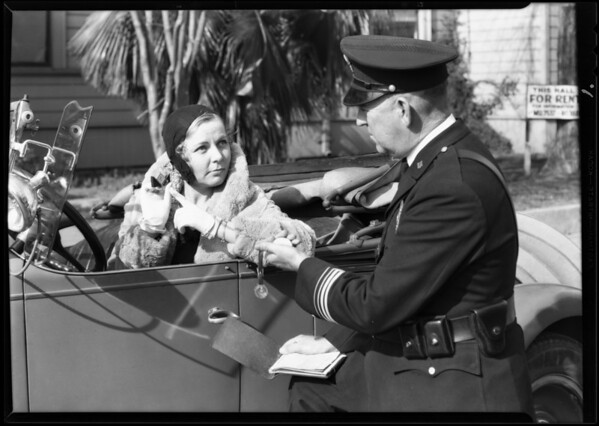 Officer and girl with watch, Southern California, 1930