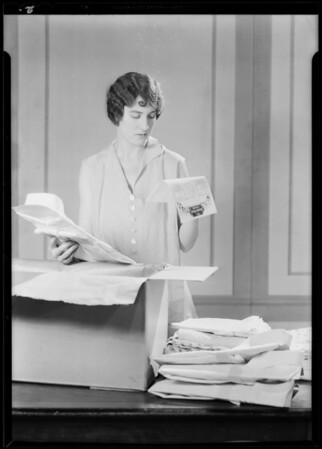 Woman checking laundry, Adelaide Denman, Southern California, 1930