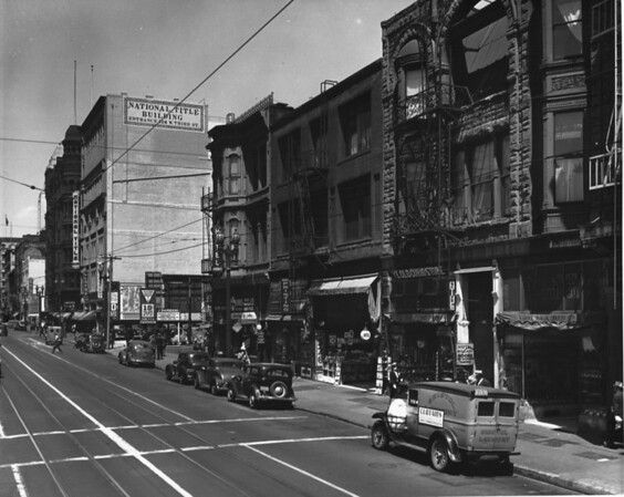 Spring street looking northeast from the 300 block, Yost Leather Company, Hotel Willard, Ye Old Curio Store, 326 South Spring Street