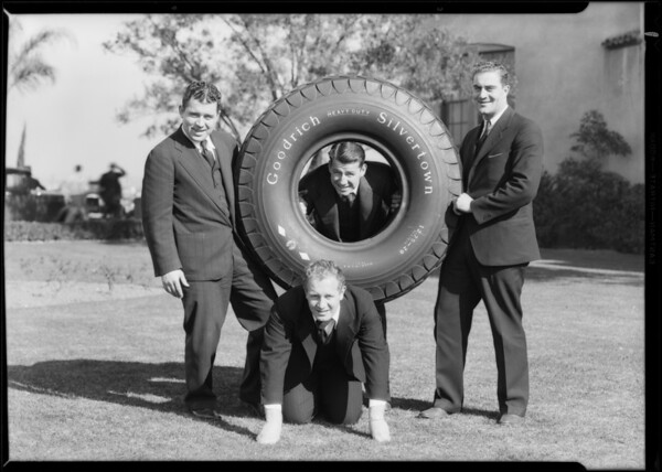 Notre Dame players & tire, Pacific Goodrich Rubber Co., Southern California, 1930