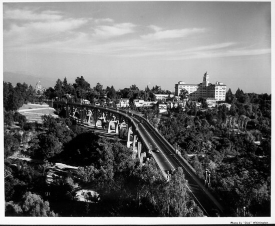 An aerial view of the Colorado Street Bridge with the Vista Del Arroyo Hotel to the right and the Pasadena City Hall to the left