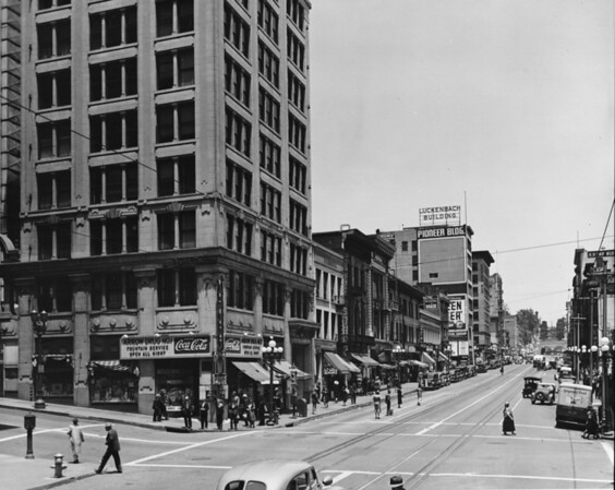 In Downtown Los Angeles facing north on the corner of South Hill Street and West Fourth Street Arrow Drug No. 1, Luckenbach Building, Pioneer Building