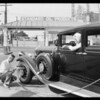 Putting air in tires, Southern California, 1931