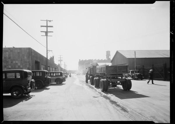 Trucks blocking McPherson Street, Southern California, 1932