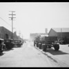 Trucks blocking McPherson Street, Southern California, 1932