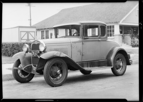Ford coupe showing damage, Southern California, 1931