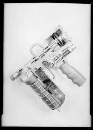 Shipping grease gun via American Airways - close up of gun, Burbank, CA, 1932