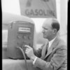 Earl Cooper and device for testing gas value, Southern California, 1932