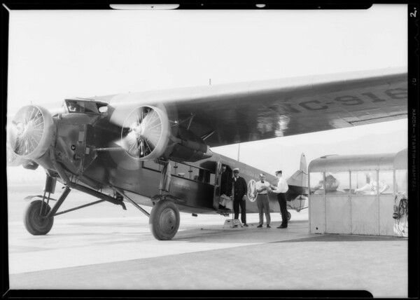 Shipping grease gun via American Airways - close up of gun, Burbank, CA, 1932