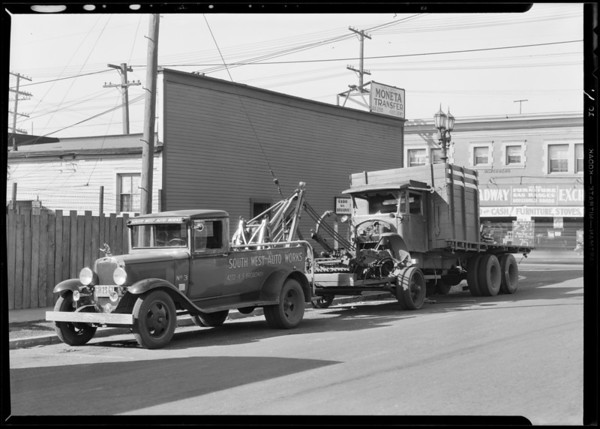 Tow car and wrecked truck, Southern California, 1932