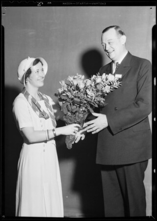 Presenting roses to president & autographing smock, Southern California, 1932