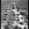 Crowds etc. on tract and at well, Southern California, 1931