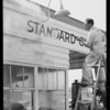 Cleaning Standard service station at West 12th Street and South Broadway, Los Angeles, CA, 1934