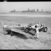 Babe Stapp and Gregg's ship, Clover Field [Santa Monica Airport], Santa Monica, CA, 1933