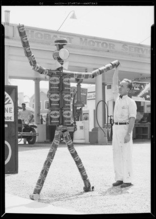 Tin can man at 3rd and Hobart filling station, West 3rd Street and South Hobart Boulevard, Los Angeles, CA, 1933