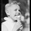 Boy eating ice cream cone, Southern California, 1932