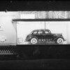 Vogue Tyre board with Nash sedan, Southern California, 1935