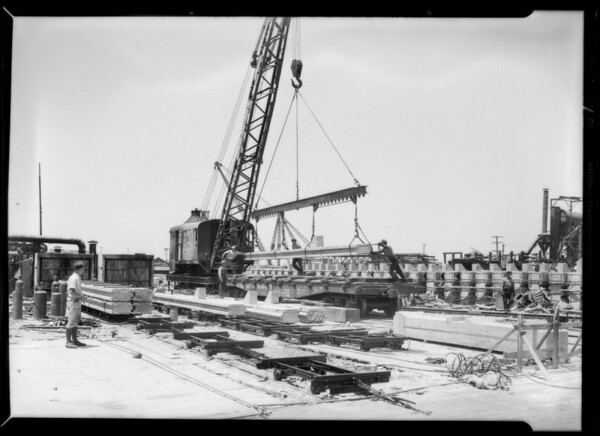 Treating concrete piles with asphalt, Southern California, 1932